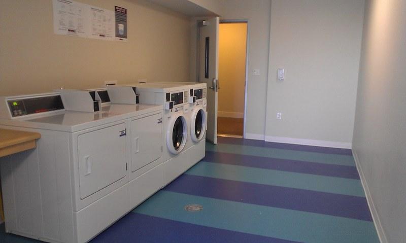 lb senior apartments laundry area